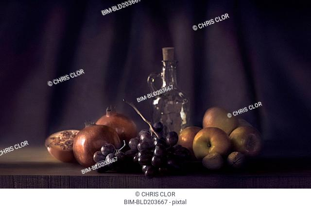 Fruit and bottle on table