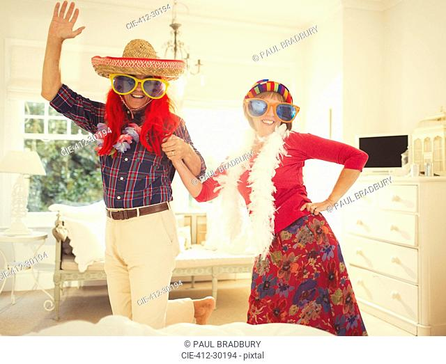 Portrait silly mature couple dancing in costumes