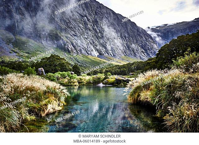 New Zealand, south island, Gertrude Saddle, jagged solid rock, high alps, mountain lake, steppe grass