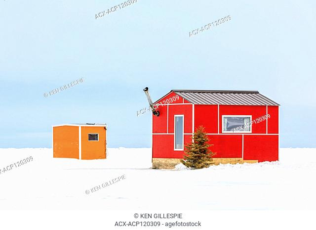 Colourful Ice fishing shacks on Lake Winnipeg, Gimli, Manitoba, Canada