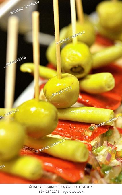 Olives and pepper. Pintxos or Tapas. Food very Typical in the Basque country. Spain