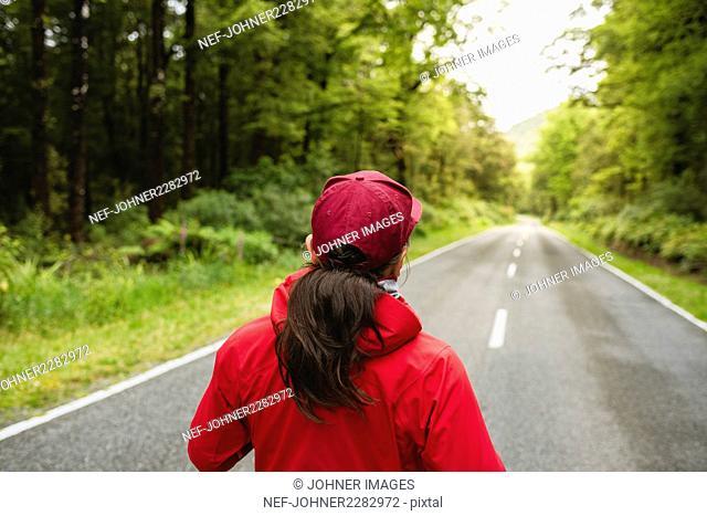 Woman walking, rear view