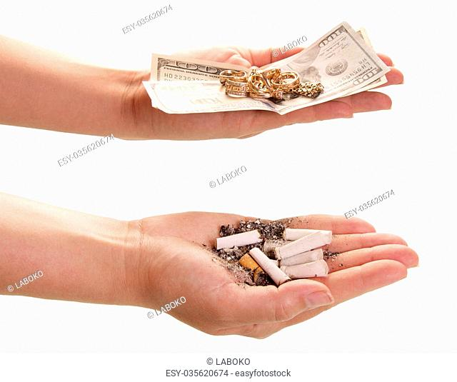 Price smoking. Cigarette butts and money in hands isolated on white background