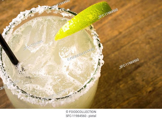 Margarita in a glass with a slice of lime and a salt-coated rim