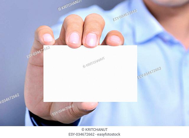 A man showing white card with blank space for text
