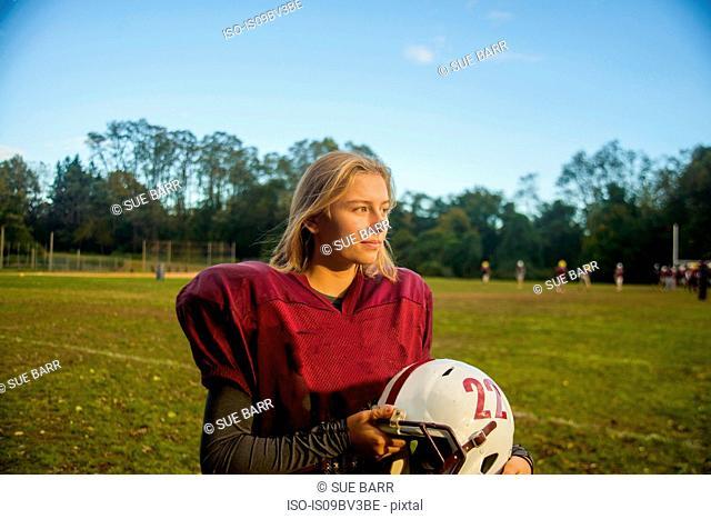 Teenage female football player on field