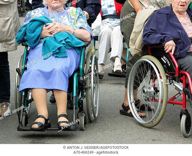 Senior people in wheelchairs