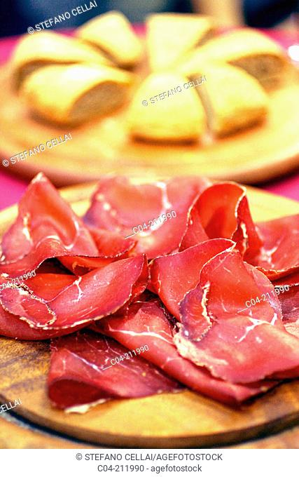 Bresaola (air-dried beef). Morbegno. Italy