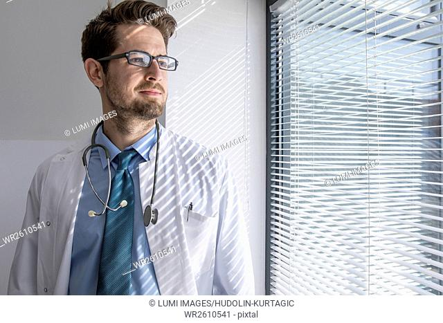 Portrait of doctor with eyeglasses and stethoscope