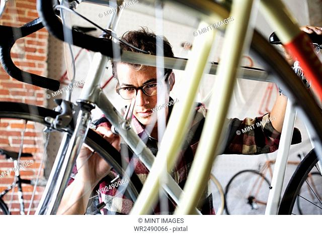 A man working in a bicycle repair shop