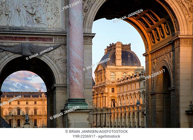 Setting sunlight on Arc de Triomphe du Carousel and Musee du Louvre, Paris France