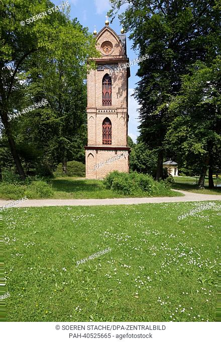 The castle grounds with the Cathlic church St. Helena and Andreas with its bell tower and the tea pavilion (R) in Ludwigslust, Germany, 10 June 2013