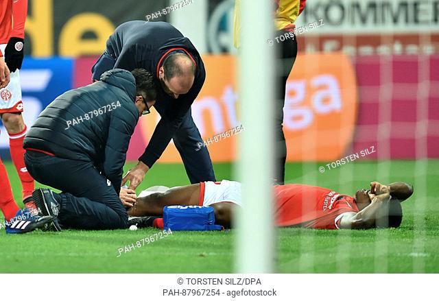 Mainz's Jhon Cordoba lies on the ground after a foul during the German Bundesliga soccer match between FSV Mainz 05 and FC Augsburg in the Opel Arena in Mainz