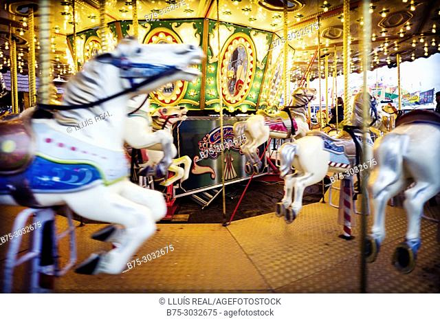 Horses on a fairground carousel at Winter Wonderland in Hyde Park. Hyde Park, London, England