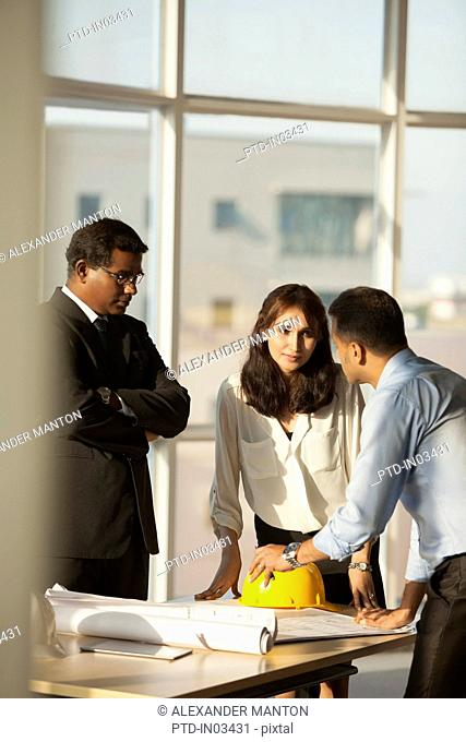 Singapore, Architect discussing building plans with customers
