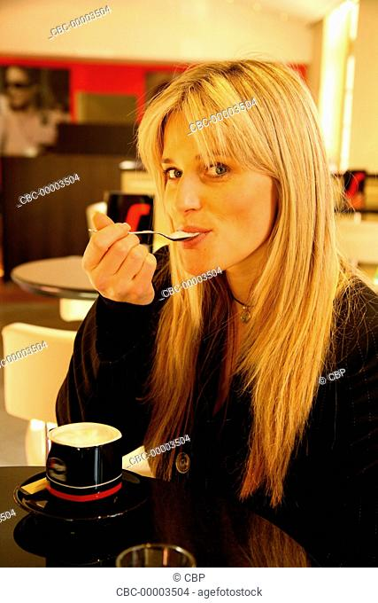 Portrait of Young Woman Sitting in a Cafe