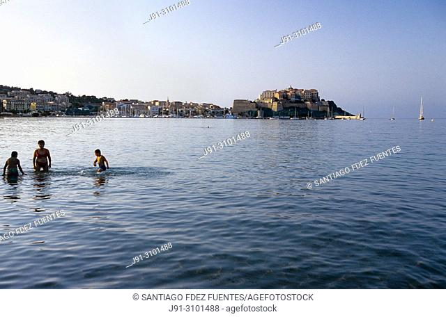 Swimming on the beaches of Calvi. Gulf of Calvi. Northwestern Corsica Island, France