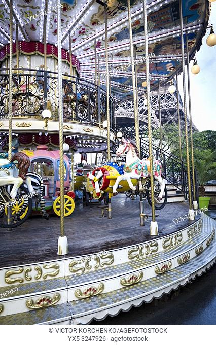 Traditionnal Parisian carousel near Eiffel Tower