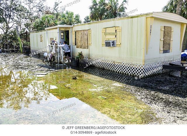 Florida, Bonita Springs, after Hurricane Irma storm rain damage, flooding, mobile park trailer home, recovery, cleanup, damage destruction aftermath, Hispanic