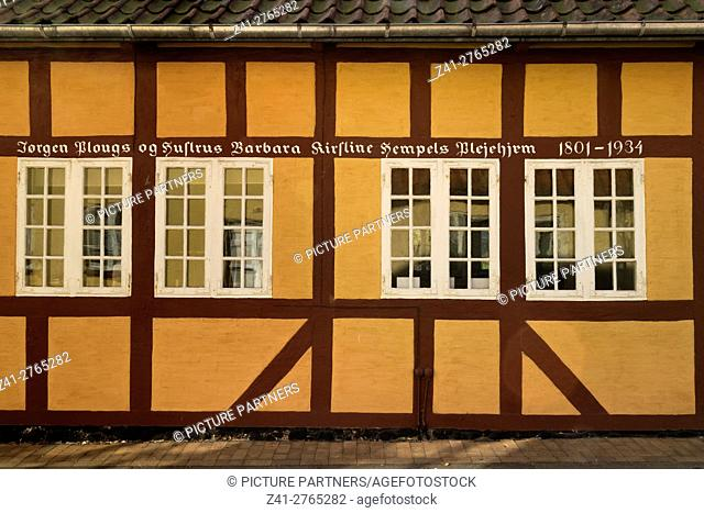 Traditional built house with a text in the city of Faaborg, Denmark