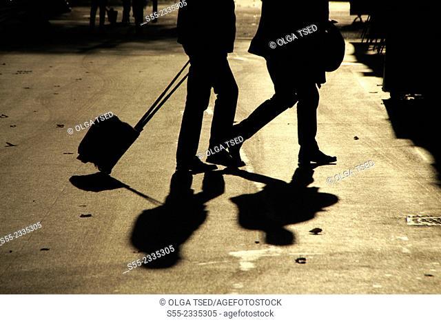 Tourists with a suitcase crossing Rambla Catalunya. Barcelona, Catalonia, Spain