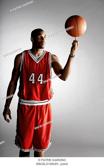 African basketball player spinning basketball