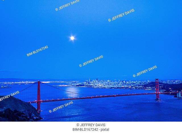 Moon in night sky over Golden Gate Bridge, San Francisco, California, United States