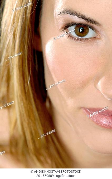 Close up of woman's face, with emphasis on skin and eyes.  She is wearing natural, clean looking daywear make-up