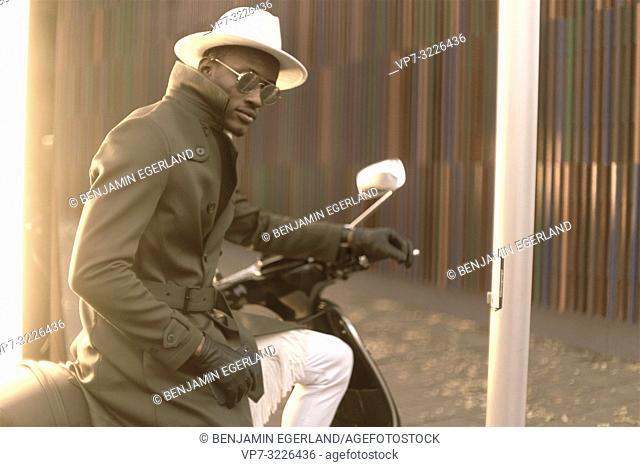 man sitting on bike, stylish, fashionable