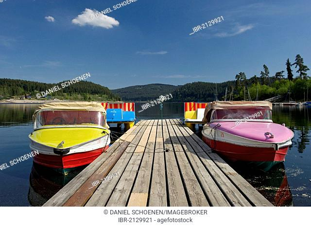 Colourful boats docked on a wharf, Schluchsee lake, Black Forest, Baden-Wuerttemberg, Germany, Europe