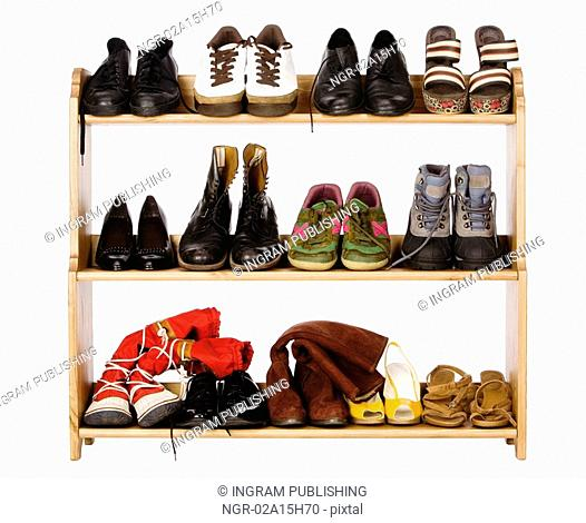 Shoes, gym shoes, boots and other footwear stand on a rackShoes, gym shoes, boots and other footwear stand on a rack
