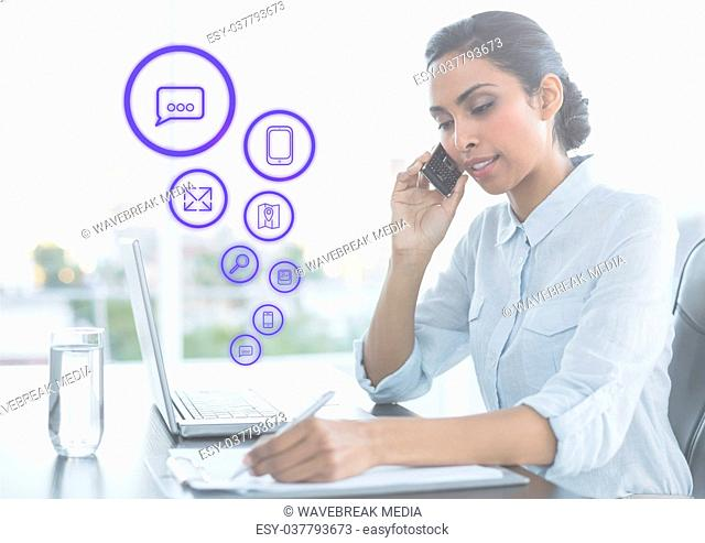 Business man on phone and writing with graph overlays