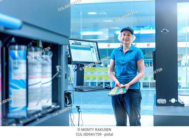 Portrait of female worker in food packaging printing factory