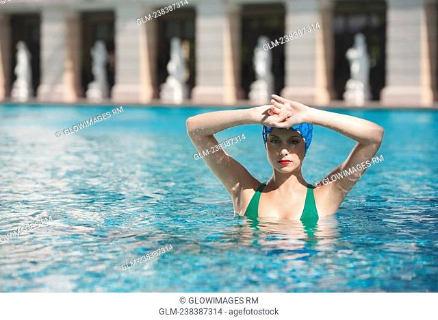 Woman doing water aerobics in a swimming pool, Biltmore Hotel, Coral Gables, Florida, USA
