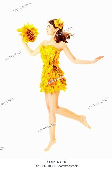 Autumn woman in fashion dress of maple leaves over white