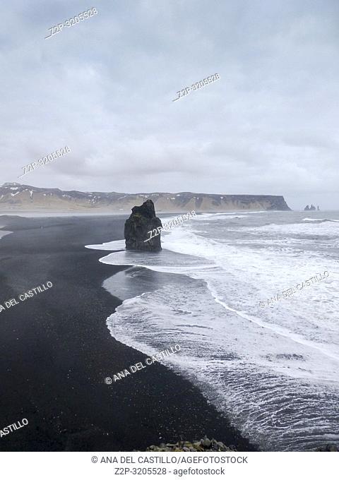 Seascape with black sand Reynisfjara beach and rocks, Vik,Iceland