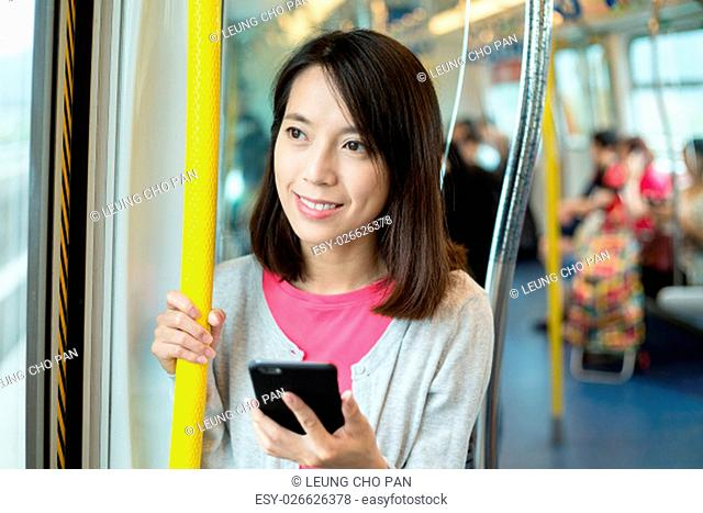 Woman use of mobile phone in train