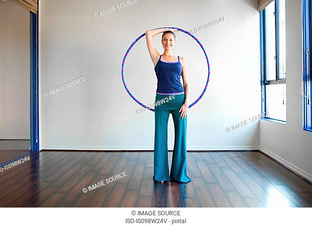 Woman holding plastic hoop for pilates