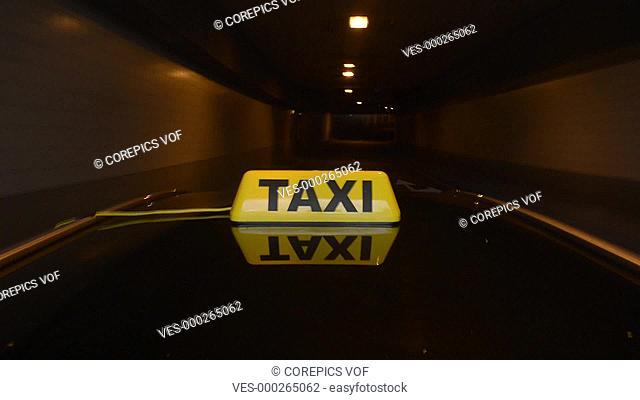 Taxicab driving through a tunnel