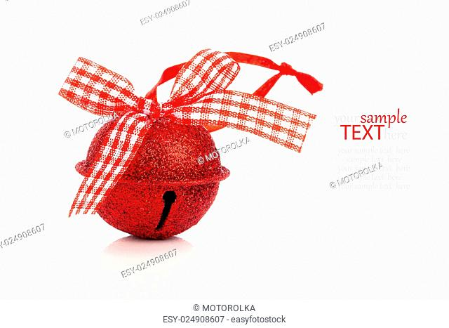 red jingle bell Christmas baubles on white
