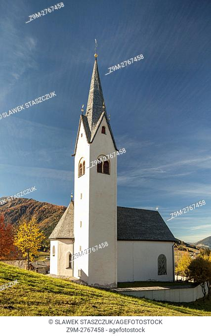 Autumn morning at the church in Sankt Oswald, Tyrol, Austria