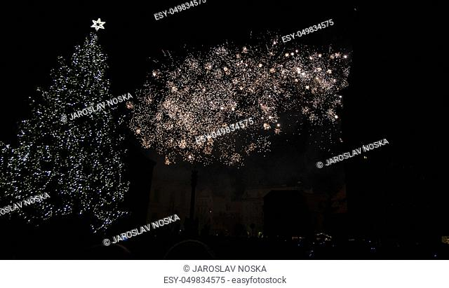 Colorful fireworks in the clouds and the beginning of Christmas time