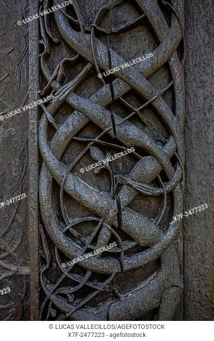 Exterior detail, Carved Doorway, Urnes stave church at Lustrafjord fjord, branch of the Sognefjord fjord, Europe's oldest stave church, Sogn of Fjordane, Norway