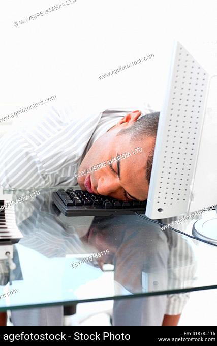 Businessman sleeping on a keyboard