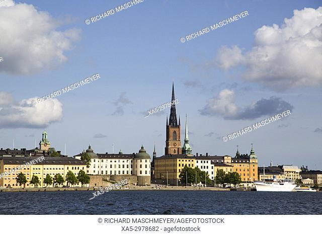 Waterfront with Riddarholmen Church (background), Gamla Stan, Stockholm, Sweden
