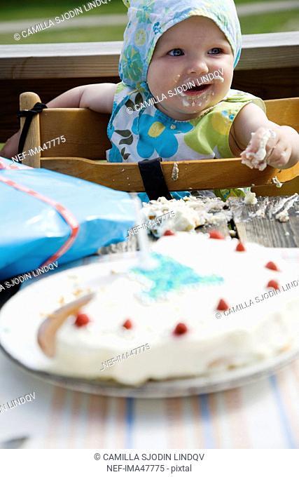 A baby eating birthdaycake, Sweden