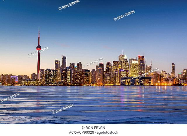 Ice in the inner harbour as viewed from Toronto Island on a cold winter's evening, Toronto, Ontario, Canada