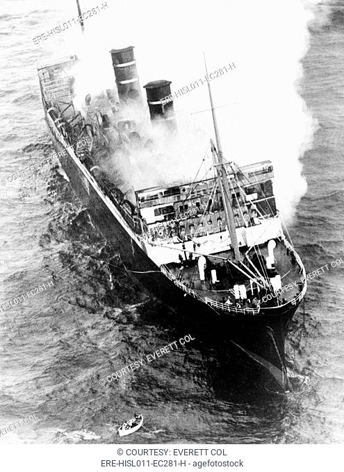 Luxury Liner Morrow Castle, smoldering off Asbury Park, New Jersey. On its final Havana to New York voyage, a storm and ship fire resulted in the death of 135...