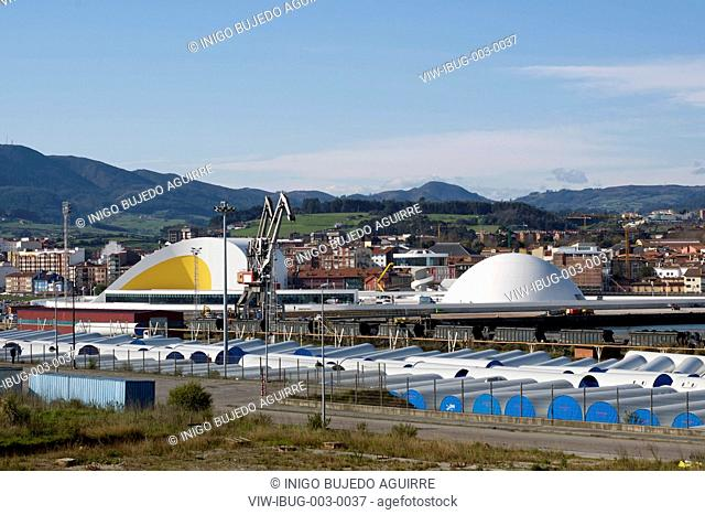 NIEMEYER CENTER IN AVILES, SPAIN BY OSCAR NIEMEYER. GENERAL LANDSCAPE MORNING VIEW OF INDUSTRIAL SITES WITH MOUNTAINS IN THE BACKGROUND AVILÉS, SPAIN, Architect