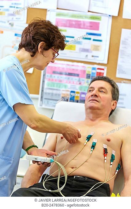 Nurse placing electrodes on patient for electrocardiogram, Ambulatory Lezo, Gipuzkoa, Basque Country, Spain
